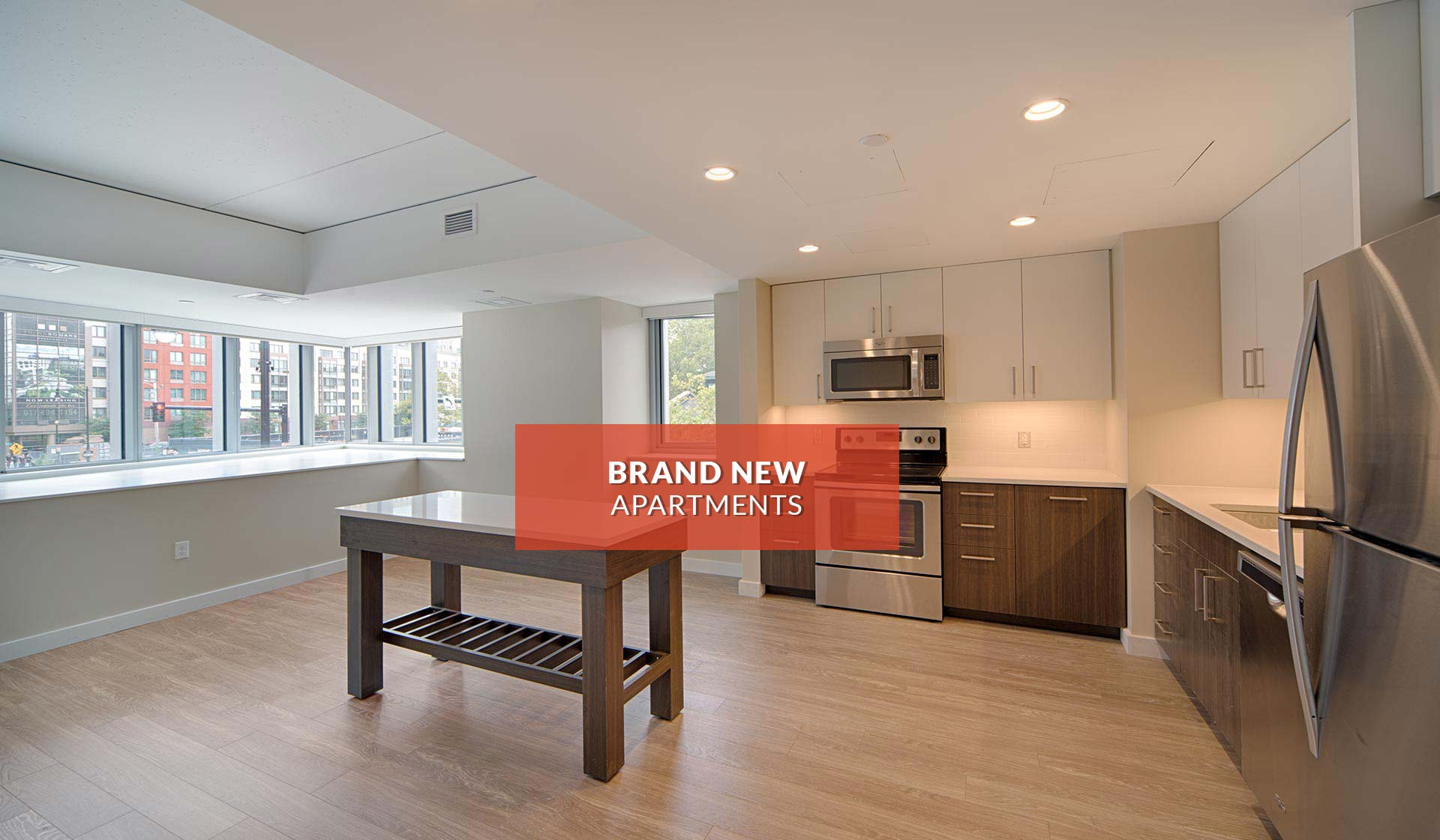 Vivo Apartment Homes | kitchen with hardwood floors and island